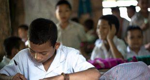Close up of school boy writing in classroom teaching method